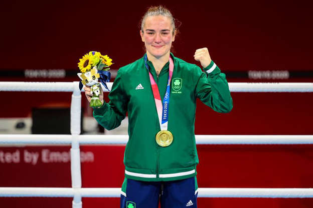 Andy Ogle standing posing for the camera: Kellie Harrington celebrates with her gold medal
