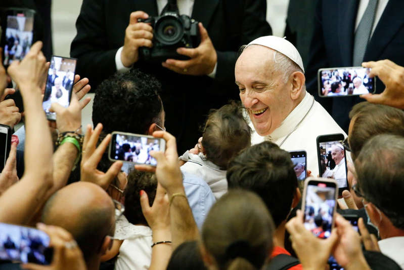 Pope Francis et al. standing in front of a crowd: Pope Francis during one of his general audiences after colon surgery - EPA