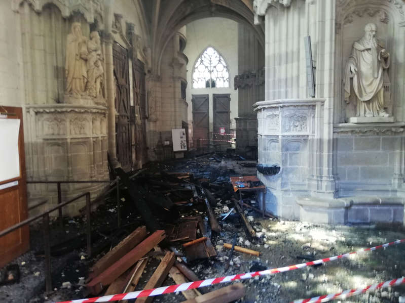 """TOPSHOT - This photograph taken on July 18, 2020, shows the remains of the burnt organ after falling from the 1st floor during a fire inside the Saint-Pierre-et-Saint-Paul cathedral in Nantes, western France. - A blaze that broke inside the gothic cathedral of Nantes on July 18 has been contained, emergency officials said, adding that the damage was not comparable to last year's fire at Notre-Dame cathedral in Paris. """"The damage is concentrated on the organ, which seems to be completely destroyed. Its platform is very unstable and could collapse,"""" regional fire chief General Laurent Ferlay told a press briefing in front of the cathedral. (Photo by Fanny ANDRE / AFP) (Photo by FANNY ANDRE/AFP via Getty Images)"""