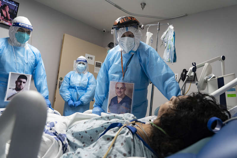 Joseph Varon et al. in a room: Houston: Medical staff members on November 8 checked on a patient at the COVID-19 Intensive Care Unit of United Memorial Medical Center. More than 11 million Americans have been diagnosed with COVID-19 in the past 10 months. Hospitals across the country, like United in Texas, are facing a surge of patients and a shortage of ICU beds.
