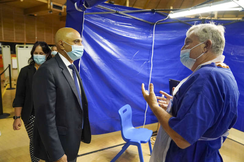 Health Secretary Sajid Javid talks to staff during a visit to the Bournemouth Vaccination Centre, in Bournemouth, Dorset. Picture date: Wednesday August 4, 2021. (Photo by Steve Parsons/PA Images via Getty Images)