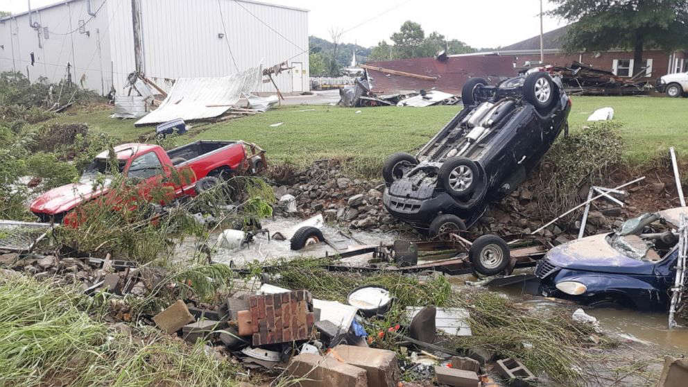 a car parked in a grassy yard: Massive destruction from flooding near Erin, Tenn., killed at least 10 people and left dozens missing on Saturday, Aug. 21, 2021.
