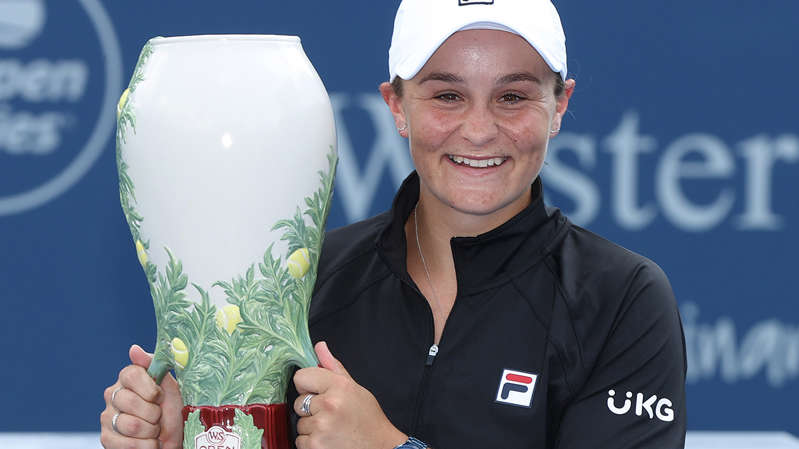 Ashleigh Barty posing for the camera: Ash Barty has claimed her fifth title of the year in Cincinnati.