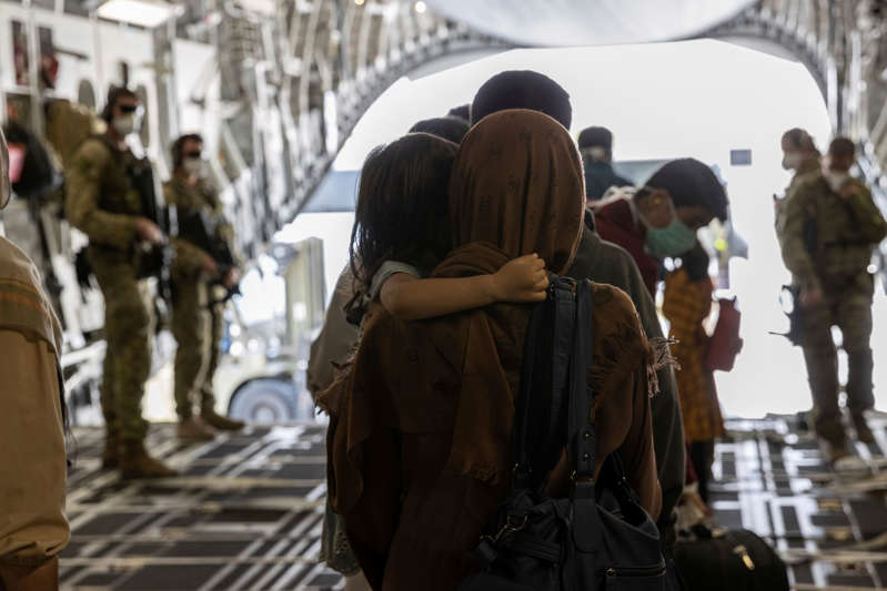 In this image provided by the Australian Defense Force on Sunday, Aug. 22, 2021, Afghanistan evacuees arrive at Australia's main operating base in the Middle East, on board a Royal Australian Air Force C-17A Globemaster.