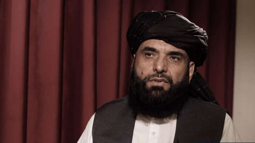 a man wearing a hat: Taliban spokesman Dr Suhail Shaheen says there is 'no need' for the US to extend their military occupation in Afghanistan