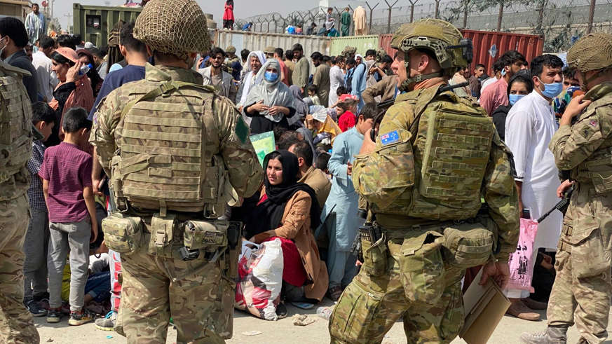 a group of people in uniform: The scenes outside Kabul airport