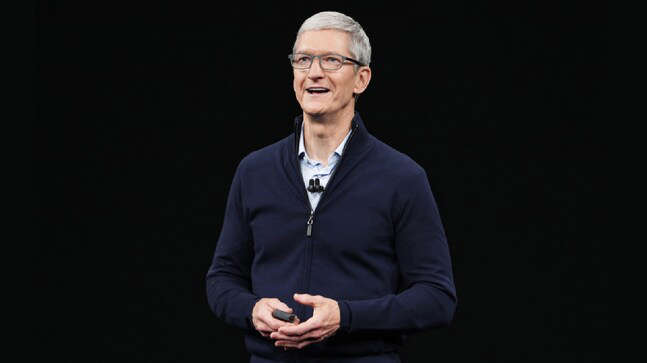 Tim Cook wearing a suit and tie
