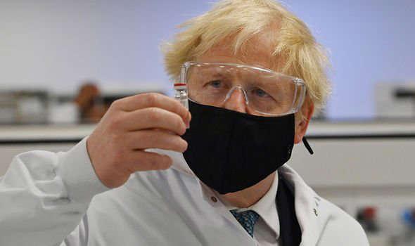 a person wearing glasses: Prime Minister Boris Johnson