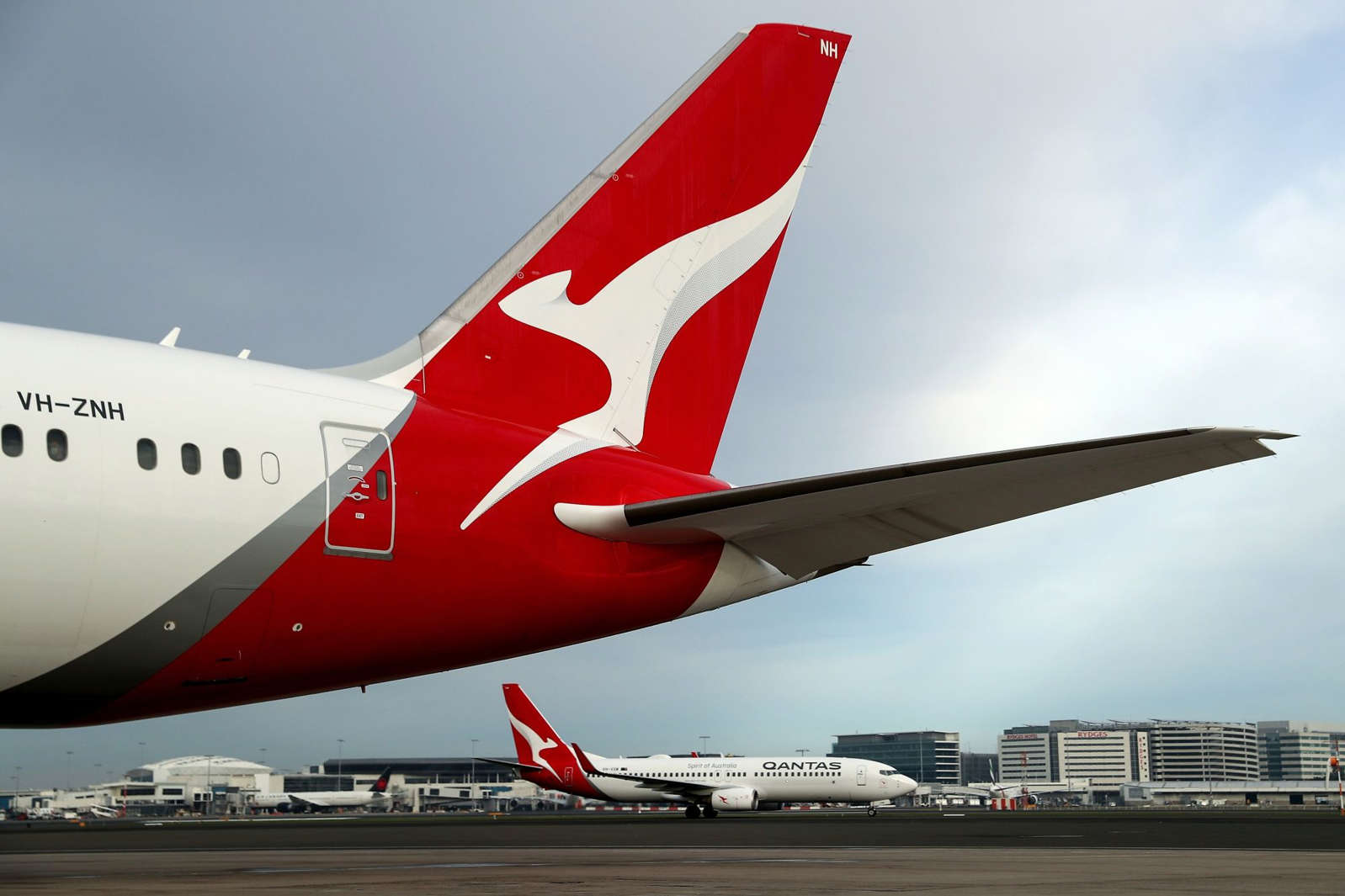 a large passenger jet sitting on top of a runway: Qantas Operations at Sydney Airport As Airline Is Set to Emerge From Covid Mess Stronger Than Ever