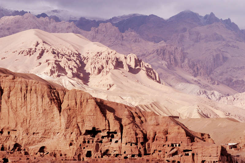 a canyon with a mountain in the background: The Koh-E Baba mountains surrounding the Bamiyan Valley in Afghanistan, pictured in November 2003.