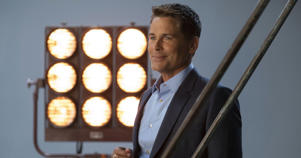 Rob Lowe wearing a suit and tie: ADAM ROSE/NETFLIX