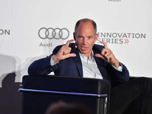 a man wearing a suit and tie talking on a cell phone: Marc Randolph, former Netflix CEO. George Pimentel/Getty Images for Audi