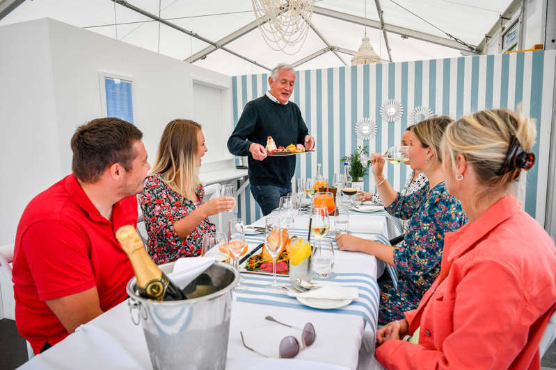 Steve Ridgway et al. standing around a table: Restaurants in Cornwall are operating at full capacity and are struggling to meet demand due to an influx of visitors this summer (Ben Birchall/PA) (PA Archive)