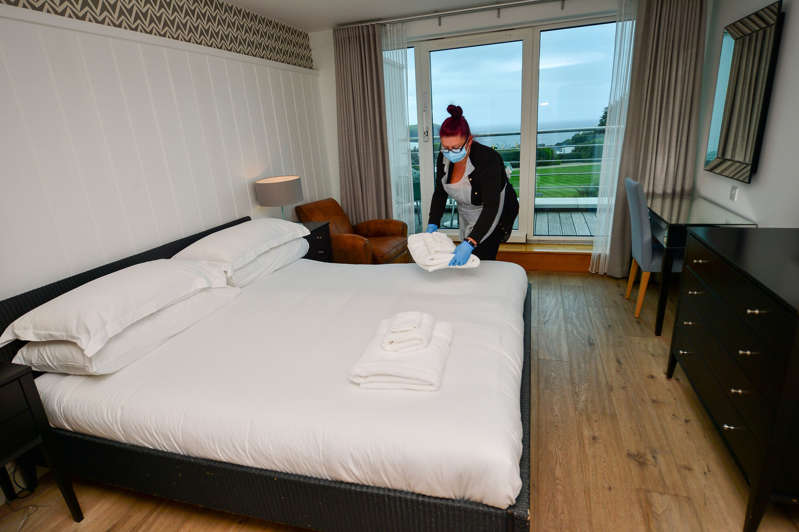 a bedroom with a bed and a window: Hoteliers were struggling to find staff to fill vacancies at their hotels (Ben Birchall/PA) (PA Archive)