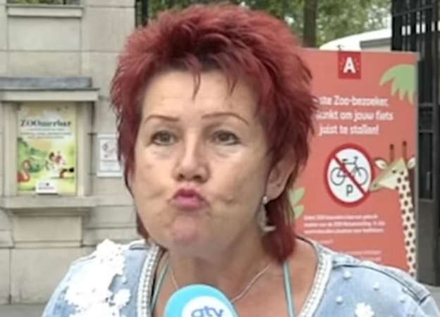 a woman standing in front of a building: Adie and Chita blow each other kisses when she visits Pic: ATV