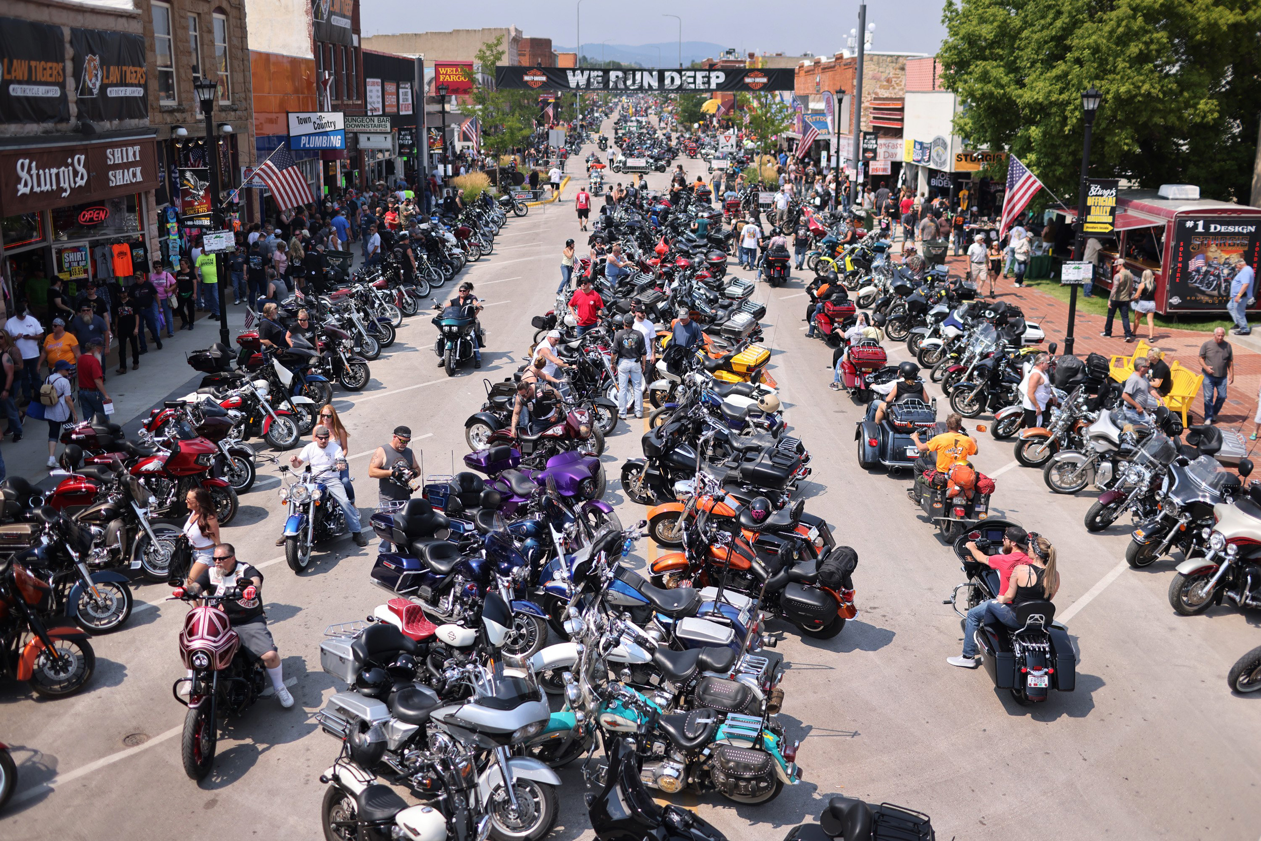 a group of people on a motorcycle in a parking lot