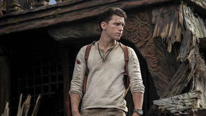 Tom Holland standing in front of a building: Tom Holland in Uncharted