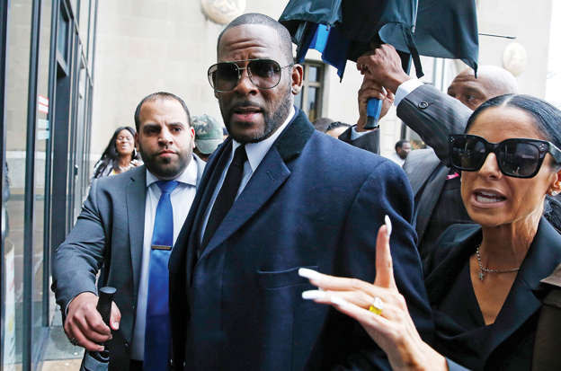 R. Kelly standing in front of a crowd posing for the camera