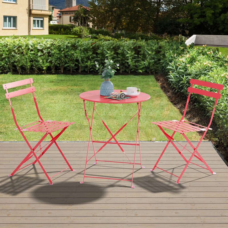 a couple of lawn chairs sitting on top of a chair: Marcela Round Long Bistro Set
