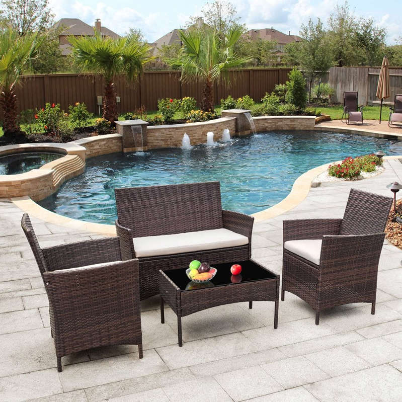 a couple of lawn chairs sitting next to a pool of water: Vineego 4 Pieces Outdoor Patio Furniture Sets