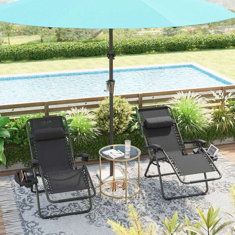 a chair sitting in front of a body of water: Rozzer Long Reclining Chaise Lounge Set
