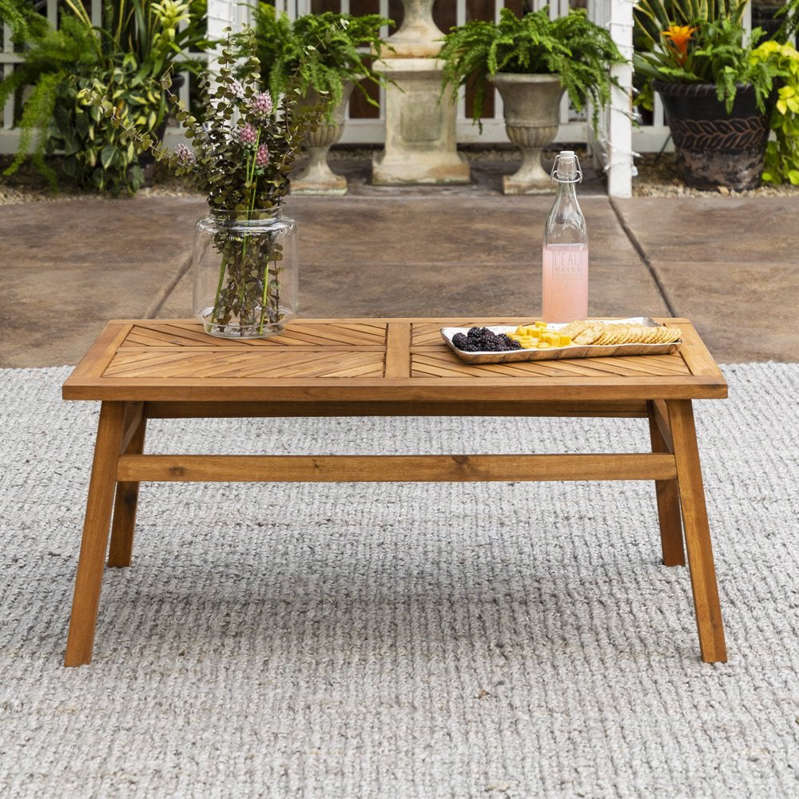 a vase of flowers on a wooden bench: Manor Park Wood Outdoor Coffee Table with Chevron Design, Brown