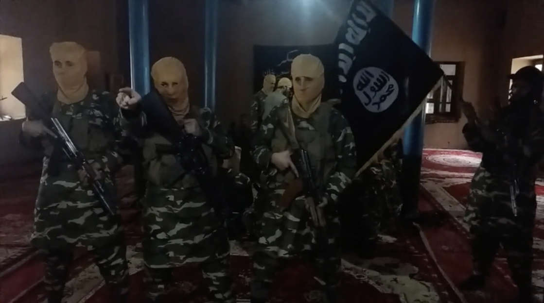 a group of people in a room: Footage from an ISIS-K video confiscated on March 21, 2018 and published in part on April 18, 2018 by U.S. Central Command shows what appears to be ISIS-K fighters training inside of a mosque in Darzab district, Jowzjan province, northern Afghanistan. The group was beaten back by a combination of U.S. strikes along with separate Afghan government and Taliban offensives, but the jihadis threatened to resurge in 2021 with a new uptick in attacks.