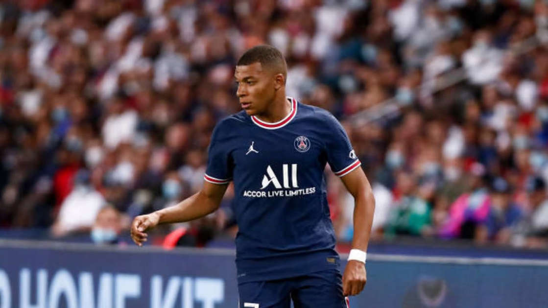a man standing in front of a crowd: Mbappe wants to join Real   Catherine Steenkeste/Getty Images