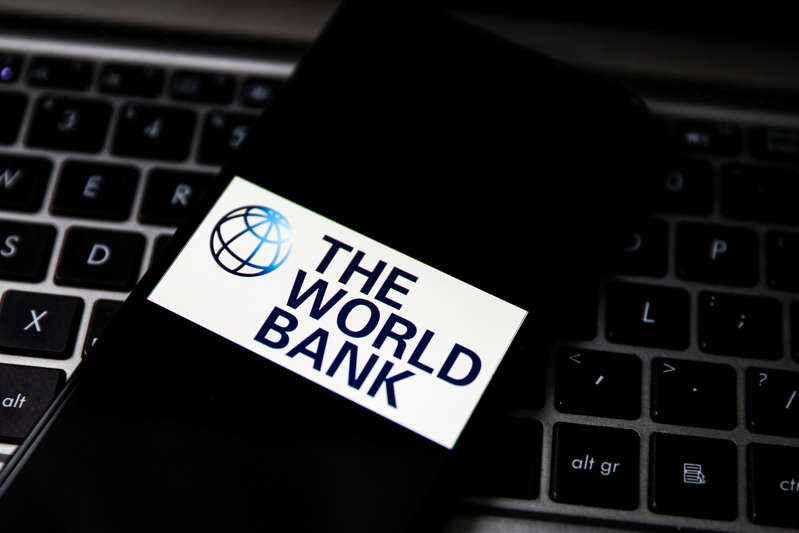 The World Bank logo is displayed on a mobile phone screen photographed for illustration photo. Gliwice, Poland on May 5, 2021. (Photo by Beata Zawrzel/NurPhoto via Getty Images)