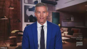 Ryan Serhant wearing a suit and tie: (