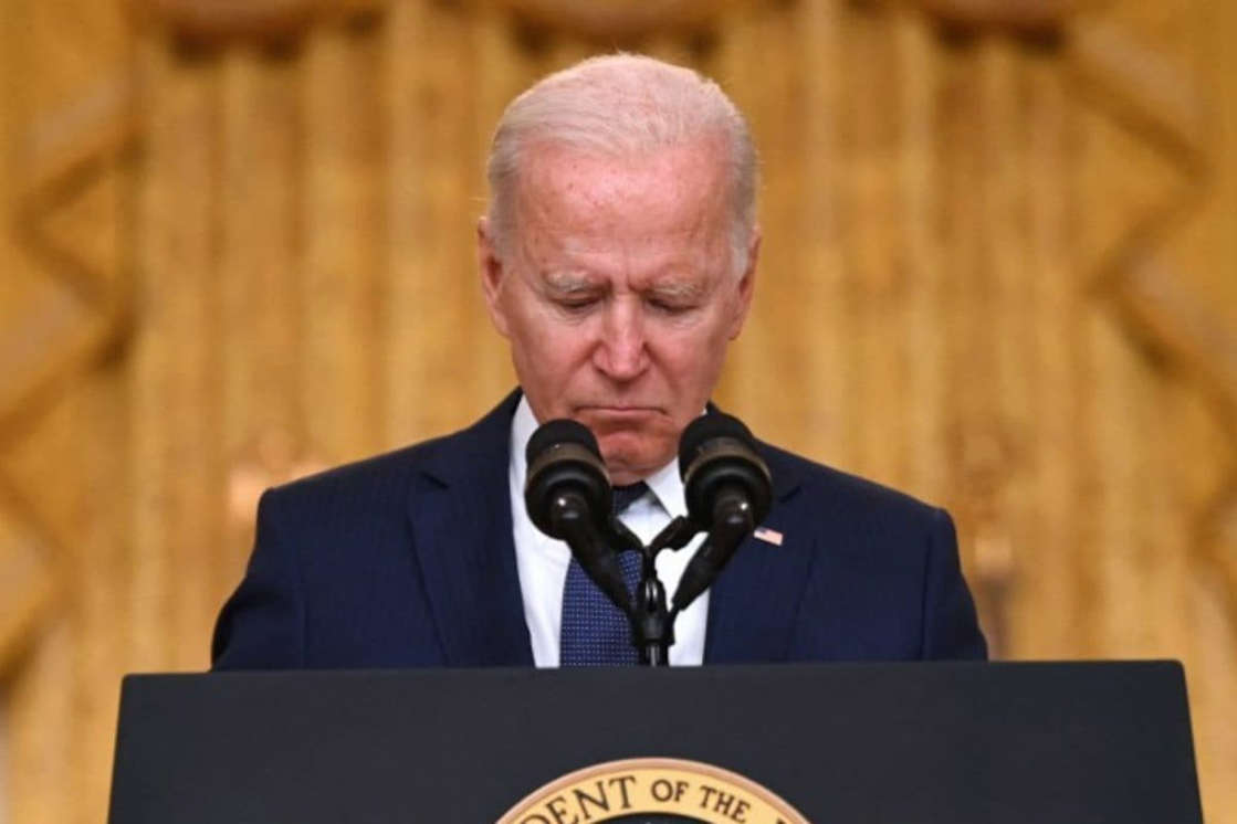 Joe Biden wearing a suit and tie: Americans Call US Role 'Failure' in Afghanistan, Biden's Approval Rating At All-time Low: Survey