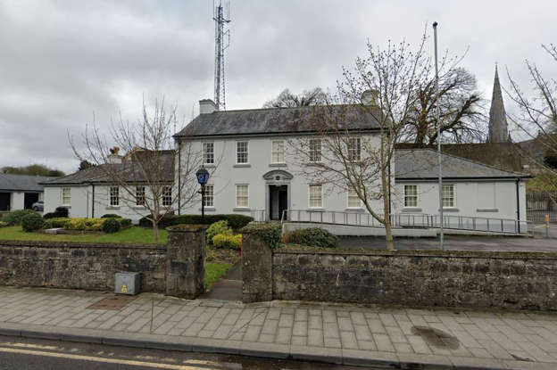 a small clock tower in front of a house: Trim Garda Station, Co Meath