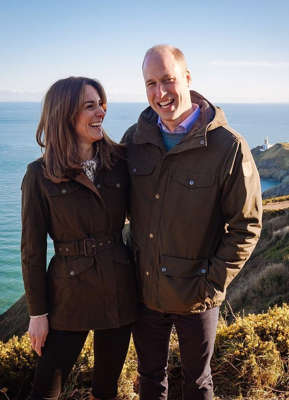 Prince William, Duke of Cambridge standing next to a body of water posing for the camera: Kate and William during their trip to Ireland and they have now used this photo from Howth Head as their new profile photos Pic: Kensington Royal