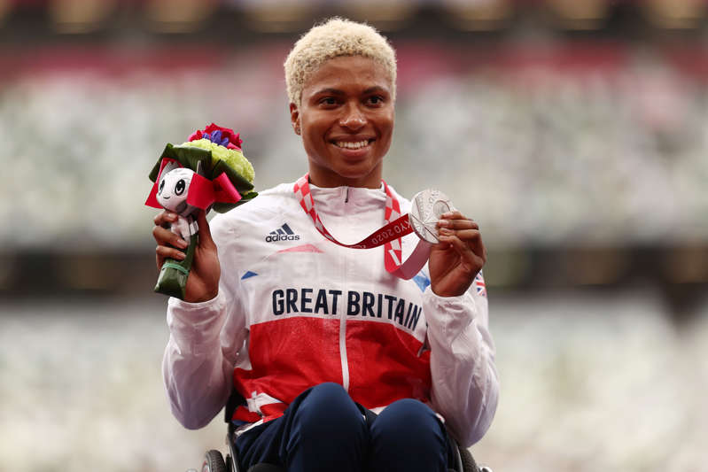 TOKYO, JAPAN - AUGUST 29: Silver medalist Kare Adenegan of Team Great Britain poses in the podium after Women's 100m T34 on day 5 of the Tokyo 2020 Paralympic Games at Olympic Stadium on August 29, 2021 in Tokyo, Japan. (Photo by Dean Mouhtaropoulos/Getty Images)