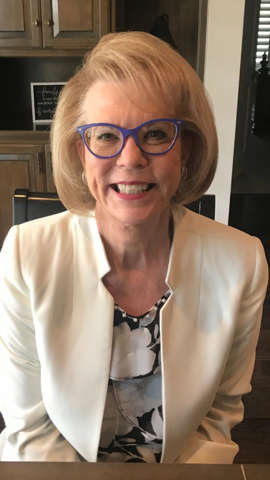 a person wearing glasses and smiling at the camera: Terry Neese