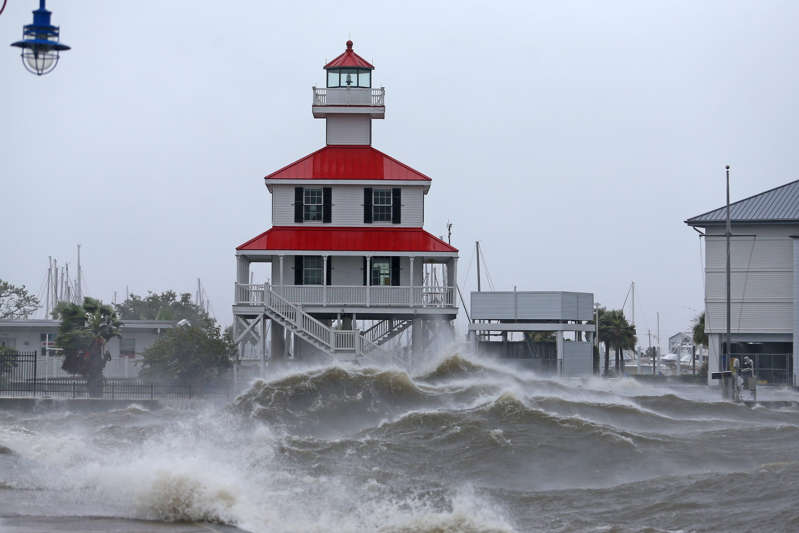 a large ship in a body of water: Waves crash against the New Canal Lighthouse on Lake Pontchartrain as the effects of Hurricane Ida begin to be felt in New Orleans on Aug. 29.