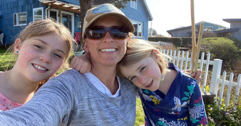 a woman holding a little girl posing for a picture: Sarah Ray, a professor of environmental studies at Humboldt State University in Arcata, California, with her two kids, ages 10 and seven.