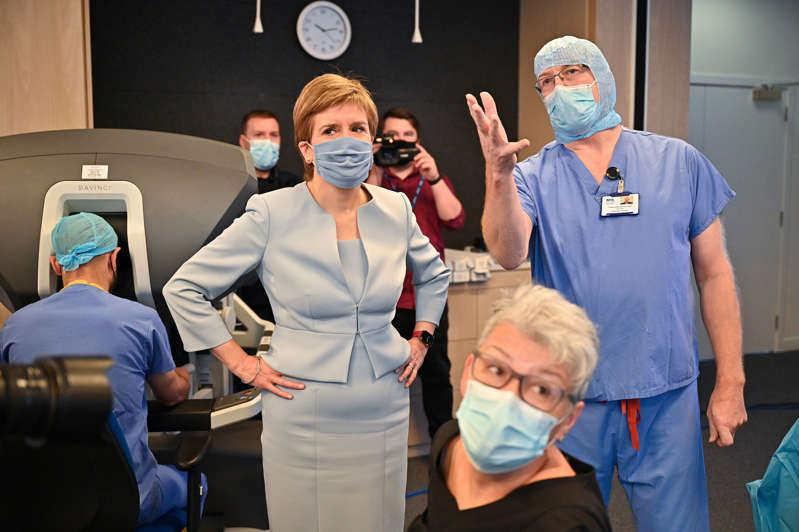 Scottish First Minister Nicola Sturgeon visits a mock theatre set up with innovative new medical equipment including robotic surgery devices at the NHS Golden Jubilee in Clydebank, Scotland, Britain August 25, 2021.  Jeff J Mitchell/Pool via REUTERS