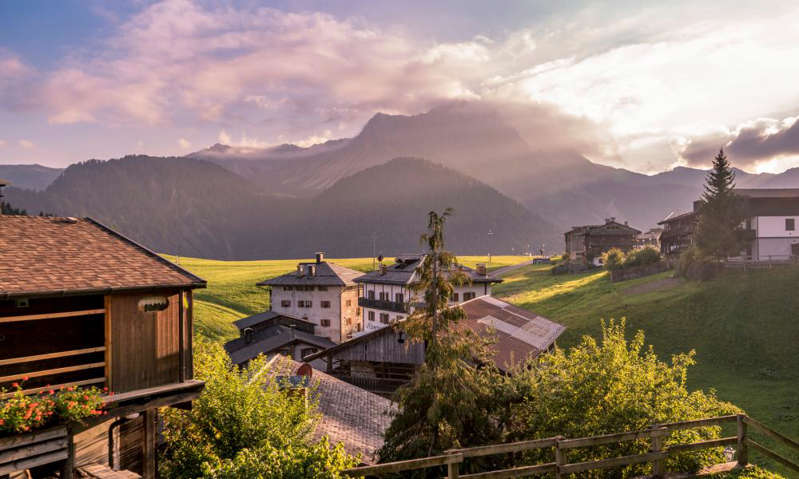 a building with a mountain in the background: Sauris di Sopra. Photograph: Getty Images