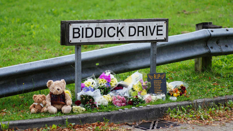 a person sitting on a bench in a garden: The mass shooting began on Biddick Drive in Plymouth