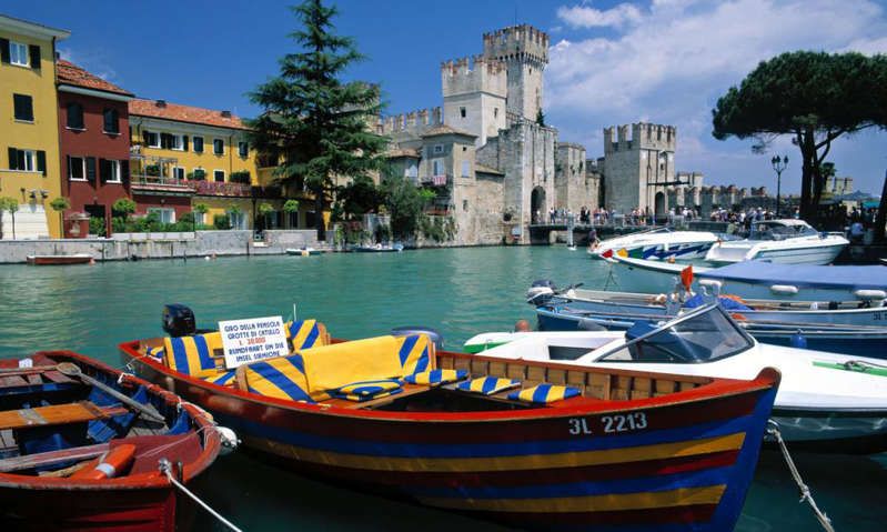 a small boat in a body of water: Sirmione. Photograph: Alamy
