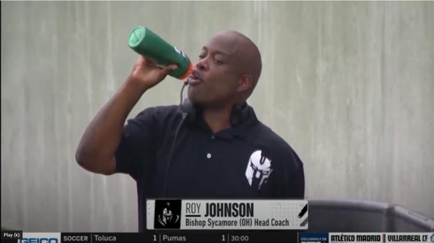 a man holding a phone: Roy Johnson