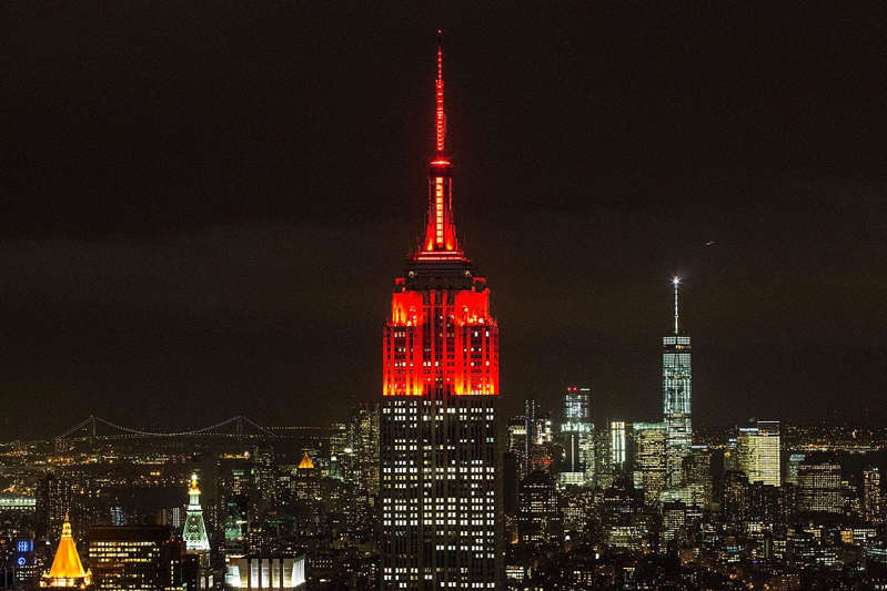 a clock tower lit up at night: Empire State Building