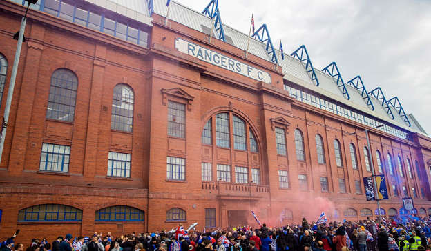 a group of people in front of a brick building: Rangers are looking for the fans responsible for the 'anti-Irish' song. Pic: Craig Williamson/SNS Group via Getty Images