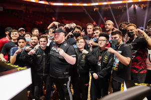 a group of people standing in front of a crowd posing for the camera: Photo via ©2021 Call of Duty League