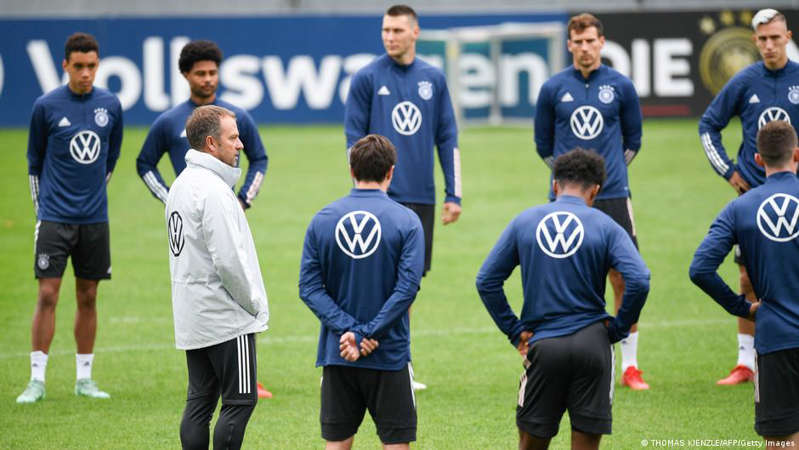 a group of football players on a field: Hansi Flick oversees his first training session as Germany coach, in Stuttgart