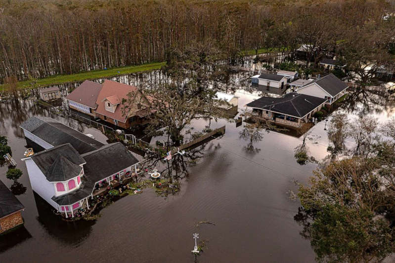 a river running through a city: Kraemer, Louisiana remains flooded after several feet of water came over the top of the levee system protecting the 7-mile stretch of homes during Hurricane Ida, Aug 30, 2021.