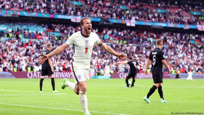a crowd of people watching a football game: A proven goalscorer such as England's Harry Kane is something Germany currently lack