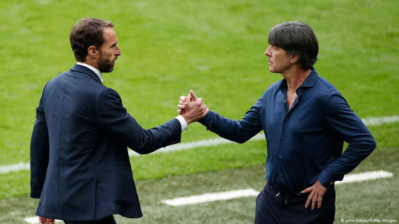 a person holding a frisbee: End of an era: Löw's long tenure as Germany coach ended with defeat by England