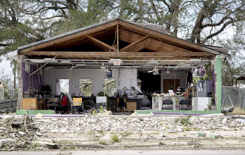 a house with trees in the background: A hair salon is destroyed by Hurricane Ida in Houma, La., Aug 30, 2021.